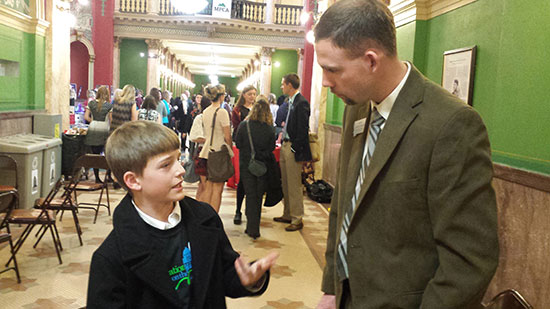 Aiden F. discusses e-cigarette legislation and tobacco marketing techniques aimed at youth with Senator Hinkle during the 2015 Montana Legislature.